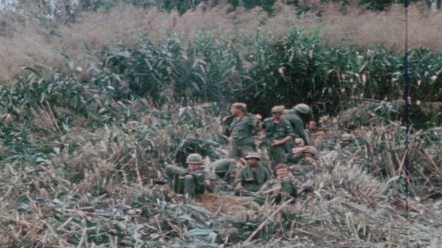 montage 327th infantry regiment soldiers waiting at landing zone for transport sharing cigarettes / vietnam - 101st airborne division stock videos & royalty-free footage