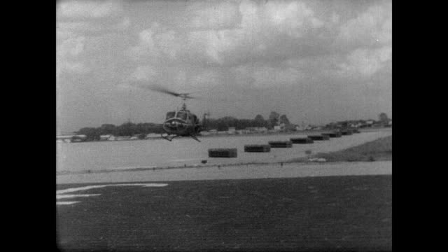 334th armed helicopter company attacks suspected vietcong hideout 15 miles northwest of saigon with mini-guns that fire six thousand rounds per... - inch stock videos & royalty-free footage