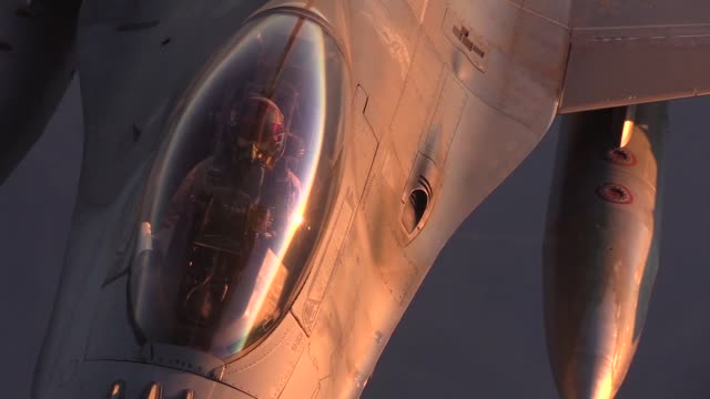 stockvideo's en b-roll-footage met a 340th expeditionary air refueling squadron detachment 1 kc135 stratotanker and its aircrew provide aerial refueling to a flight of f16c fighting... - bagram