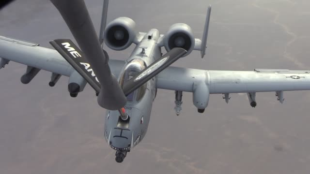 a 340th expeditionary air refueling squadron detachment 1 kc135 stratotanker and its aircrew provide aerial refueling to a flight of a10 warthogs... - schiffsmast stock-videos und b-roll-filmmaterial