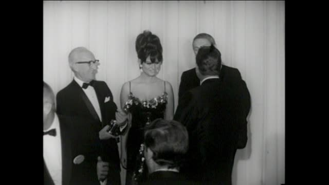 37th annual academy awards. press room claudia cardinale, steve mcqueen, george groves, angie dickinson, alain delon - academy awards stock videos & royalty-free footage