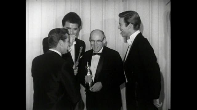 37th annual academy awards. santa monica civic auditorium. press room interviews. rosalind russell, andre previn, greg and bob sherman, richard... - andre previn stock videos & royalty-free footage