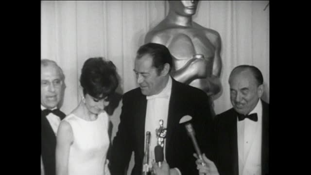 37th annual academy awards. santa monica civic auditorium press room interviews. george cukor, rex harrison, jack warner sof interview. warner bros.... - academy awards stock videos & royalty-free footage
