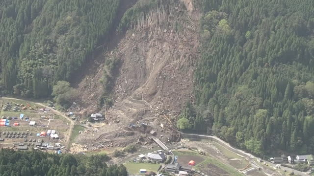 aerial shot long shot of the site of a massive landslide on april 15 in the city of nakatsu in oita ultimately six people were sacrificed by this... - oita city stock videos & royalty-free footage