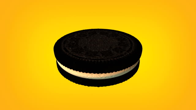 3d chocolate sandwich cookie with cream animation loop. luma matte is provided to extract the cookie. - digital animation stock videos & royalty-free footage
