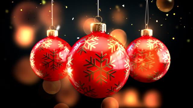 3D Rendering drei rot dekoriert Weihnachtskugeln mit Bögen auf funkelnde Hintergrundanimation nahtlos Loop-fähig