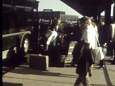 3jun1969 montage going to the airport for trip to europe war correspondents posing with their wives before boarding / chicago illinois usa - o'hare airport stock videos & royalty-free footage