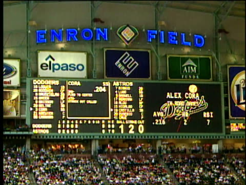 3jun2001 montage baseball game in houston texas in enron field interior of stadium shots of crowd and enron sign / houston texas usa - baseballmannschaft stock-videos und b-roll-filmmaterial
