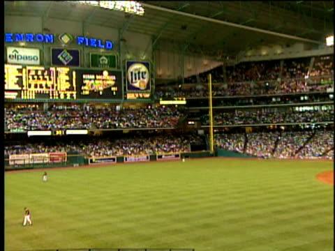 3Jun2001 MONTAGE Baseball game in Houston Texas in Enron Field Interior of stadium shots of crowd and Enron sign / Houston Texas USA