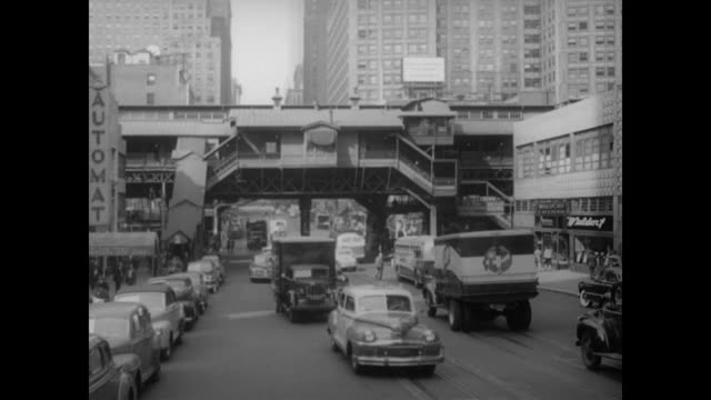 vídeos de stock, filmes e b-roll de 1948 nyc - 3rd avenue elevated subway station at 42nd street looking east - 1948