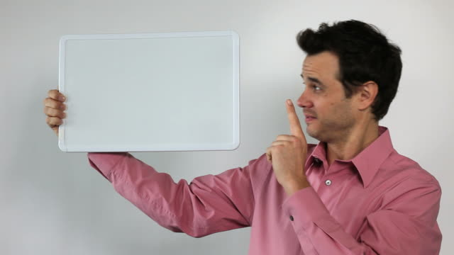 3.\tcharismatic sales guy holding white board; you, look here. - content stock videos & royalty-free footage