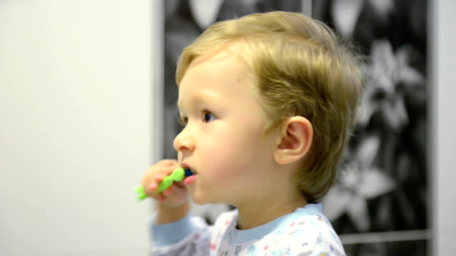 3-year-old boy brushing teeth - brushing stock videos and b-roll footage