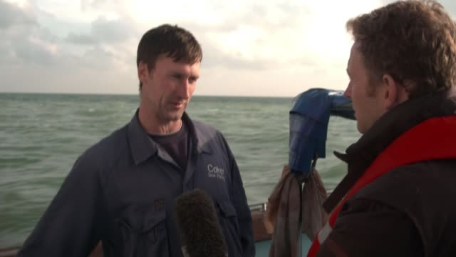 3yearold girl amongst 9 migrants rescued from dinghy in english channel kent uk dover gvs fishermen and councillor interview on rescued migrants... - kent england stock videos & royalty-free footage