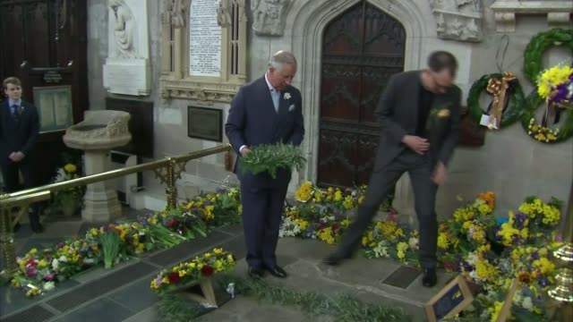 400th Anniversary of Shakespeare's death including Prince Charles performance Holy Trinity Church INT Prince Charles laying rosemary wreath on...