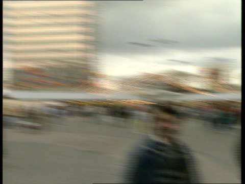 40th anniversary ceremony / refugees besiege us embassy / berlin demonstrations / mikhail gorbachev visit; alexanderplatz: general views and close... - alexanderplatz stock videos & royalty-free footage