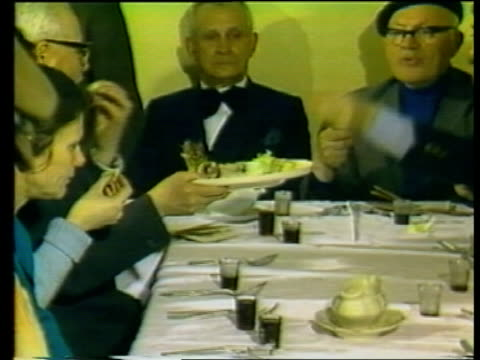 vídeos de stock, filmes e b-roll de 40th anniversary of warsaw ghetto uprising poland warsaw/ int/ polish jews singing at celebration zoom in/ jews around table / passing plate of food... - old book