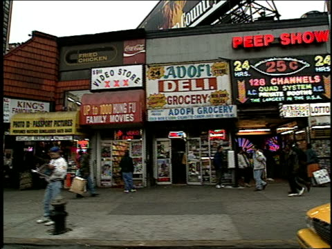 432nd street in new york city in 1994, times square peep shows and adult stores. - peeking stock videos & royalty-free footage