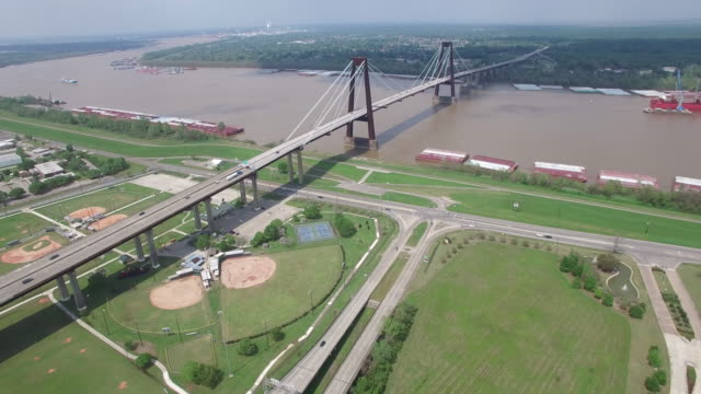 45deg pull back of bridge on mississippi river - drone aerial 4k mississippi river bridge and barge 1of14, everglades, gulf delta, new orleans, st louis, with cruise boats sailing and wildlife 4k transportation drone aerial video - mississippi river stock videos & royalty-free footage