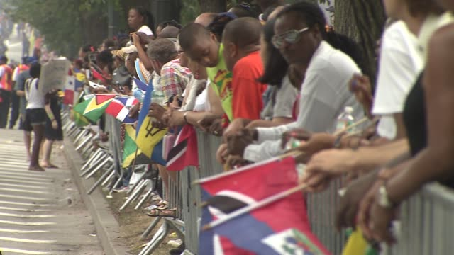 46th annual west indian day parade a crowd waves multicultural flags behind at eastern parkway brooklyn on september 01 2013 in new york new york - west indies stock videos & royalty-free footage