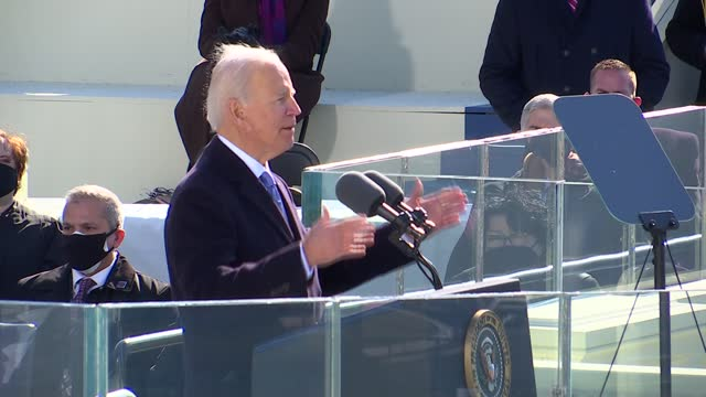 46th president of the united states joseph biden says in speech to the nation from platform at west front of the us capitol after taking the oath of... - 大統領就任式点の映像素材/bロール