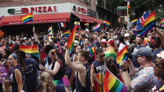 47th anniversary of the annual new york city gay pride march via 5th avenue and ending in the west village the nyc pride march is one of the largest... - delta air lines stock-videos und b-roll-filmmaterial