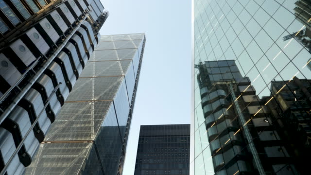 4k 10bit low angle view of tall skyscraper in the city of london looking up to the sky. financial district and heart of global business - bank stock videos & royalty-free footage