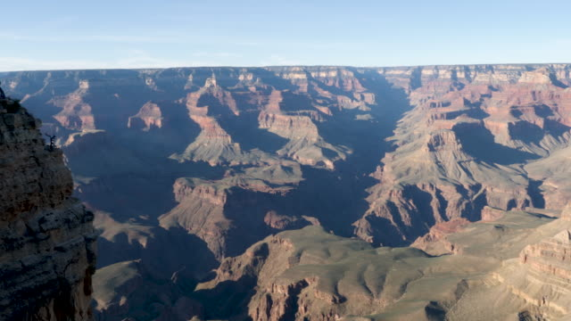 4k 10bit panning shot of the grand canyon national park cliffs and craters during golden hour in spring. - fiume colorado video stock e b–roll