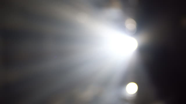 4k abstract laser spotlight background - lens flare stock videos & royalty-free footage