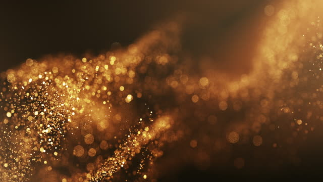 vídeos de stock e filmes b-roll de 4k abstract particle wave bokeh background - gold, award, luxury, christmas - beautiful glitter loop - dourado cores