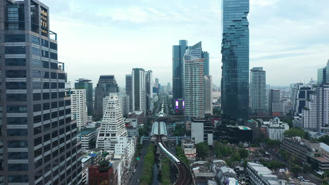 4k aerial city view of bangkok downtown, flying over bangkok, thailand - elevated train stock videos & royalty-free footage