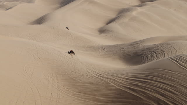 4k aerial drone dune buggy driving through the desert - dune buggy stock videos and b-roll footage