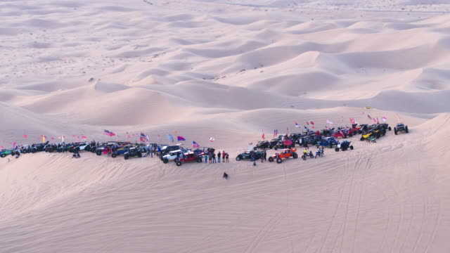 4k aerial drone dune buggy group in desert - dune buggy stock videos and b-roll footage