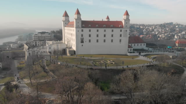 4k aerial drone shot of bratislava cityscape with castle and gardens and danube river, in slovakia - slovakia stock videos & royalty-free footage
