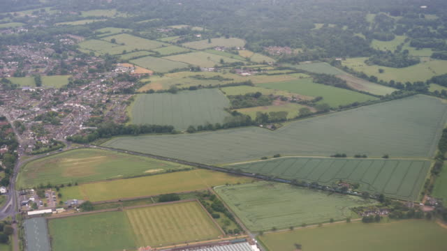4k aerial drone style footage of old windsor and rural english countryside as plane comes into land at london heathrow airport lhr - windsor england stock videos & royalty-free footage