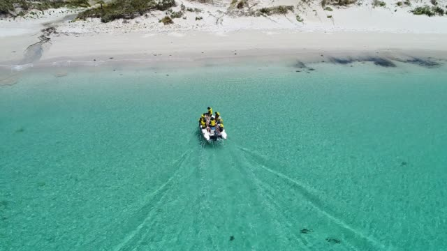 4k aerial drone travelling shot with boat on ocean