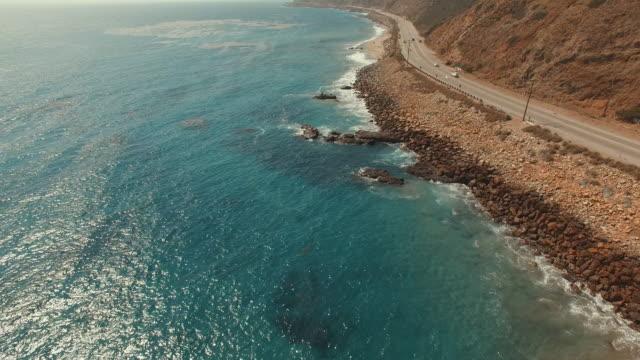 4k aerial footage of a beach in malibu, california - malibu stock videos & royalty-free footage