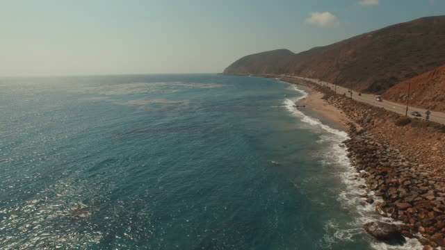 4k aerial footage of a beach in malibu, california - southern california stock videos & royalty-free footage
