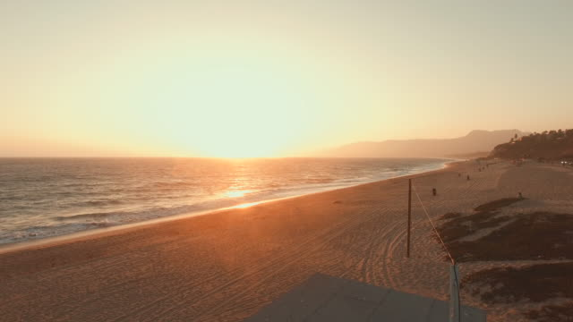 4k aerial footage of a lifeguard hut in malibu, california - malibu stock videos and b-roll footage