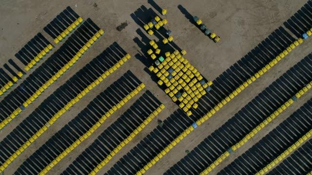vídeos y material grabado en eventos de stock de 4k aerial manufacturing station - brightly lit