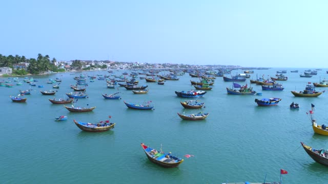 4k aerial movie of vietnamese small fishing boats and fishing ships in harbour, muine, vietnam - nautical vessel stock videos & royalty-free footage