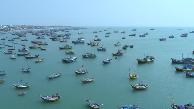 4k aerial movie of vietnamese small fishing boats and fishing ships in harbour, muine, vietnam - vietnam stock videos & royalty-free footage