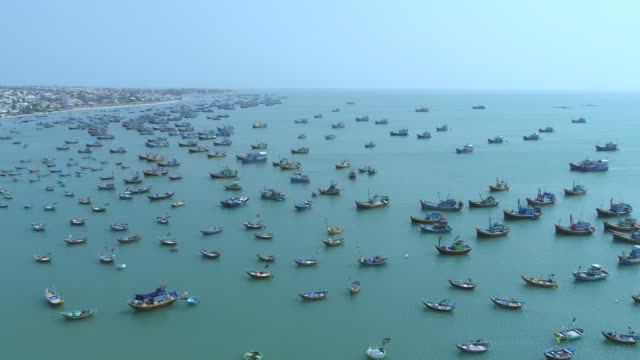4k aerial movie of vietnamese small fishing boats and fishing ships in harbour, muine, vietnam - fishing stock videos and b-roll footage