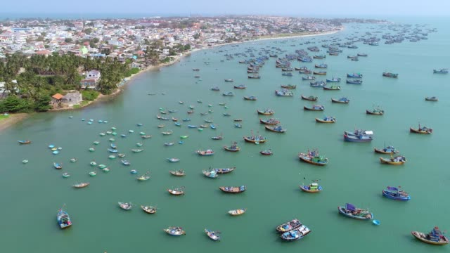 4k aerial movie of vietnamese small fishing boats and fishing ships in harbour, muine, vietnam - vietnam video stock e b–roll