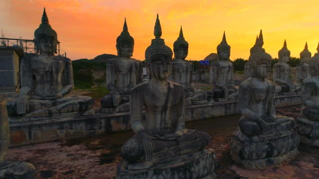 4k aerial movie shot fly over a group of buddha statue, Nakornsrithammarat, Thailand