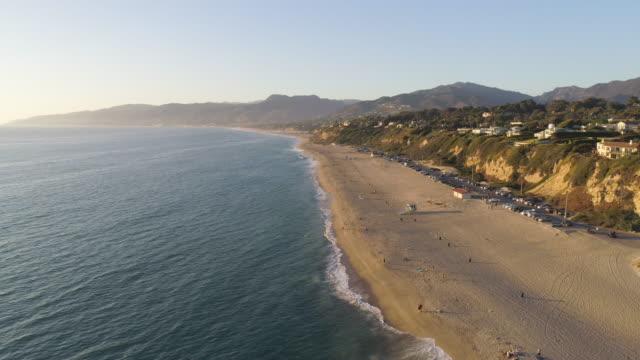 4k aerial of a beach in malibu, california - malibu stock videos & royalty-free footage