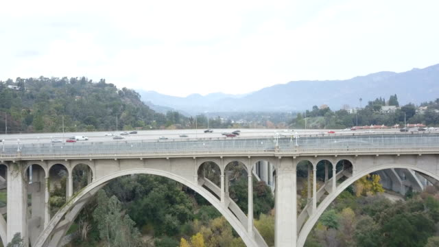 4k aerial over colorado street bridge in pasadena, california - pasadena california stock videos & royalty-free footage