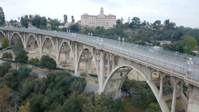 4k aerial over colorado street bridge in pasadena, california - elevated walkway stock videos & royalty-free footage