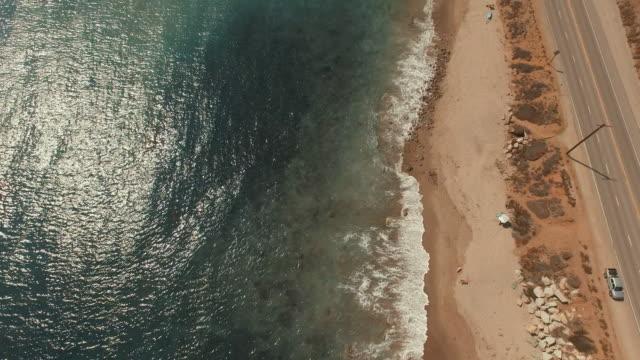 4k aerial pan up over a beach in malibu, california - malibu stock videos and b-roll footage