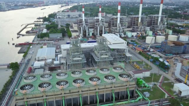 4k aerial shot of combine cycle or thermal power plant with cooling tower in asia - generator stock videos & royalty-free footage