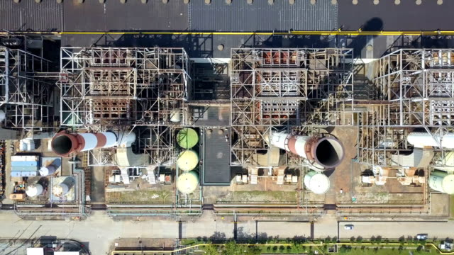 4k aerial shot of combine cycle or thermal power plant with cooling tower in asia - cooling tower stock videos & royalty-free footage